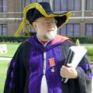 Prof. Marcus in full academic regalia.